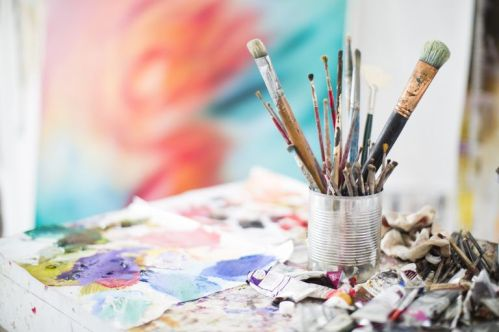 paints-and-paint-brushes-in-an-artists-studio-684069031-5a83420dba61770037081696